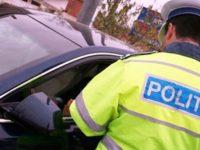 AMENZI PIPERATE: Vorbeşti la telefon la volan sau nu porţi centura de siguranţă? 1.600 lei amendă